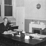 Albert Robert Hayward co-founder with his brother Edwin shown working at his desk November 1950