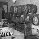 Hogsheads awaiting bottling. Note cellars were lit by gas lamps throughout